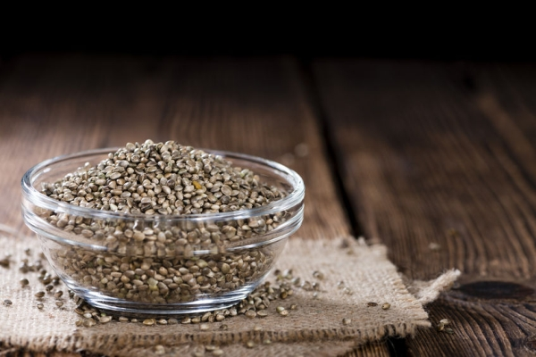 41939822 - hemp seeds (close-up shot) on an old wooden table