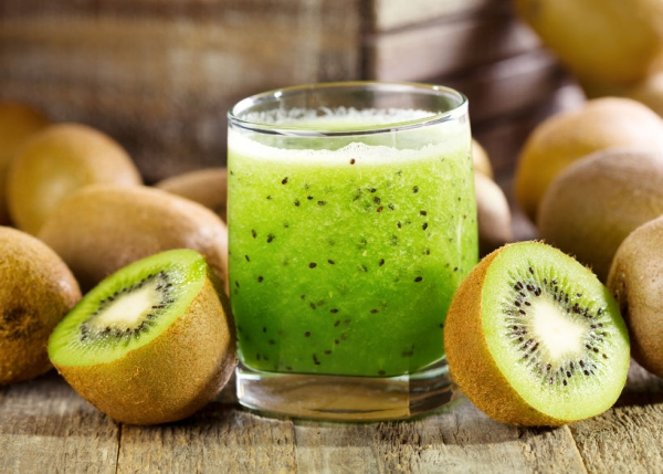 24880401 - glass of kiwi juice with fresh fruits on wooden table
