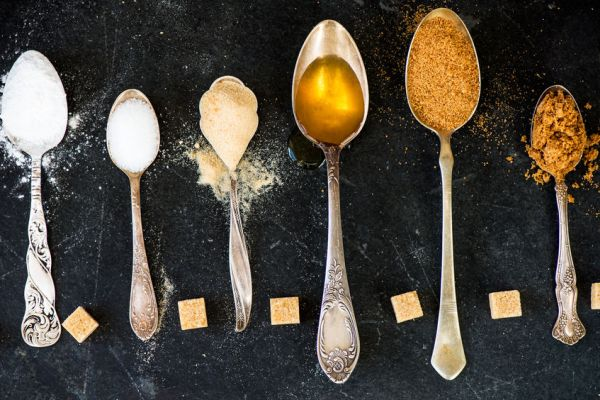 57438698 - different kinds of sugar in the spoons, such as coconut sugar, pure cane sugar, icing sugar, agave syrup, dark brown soft sugar, golden caster sugar, demerara cubes