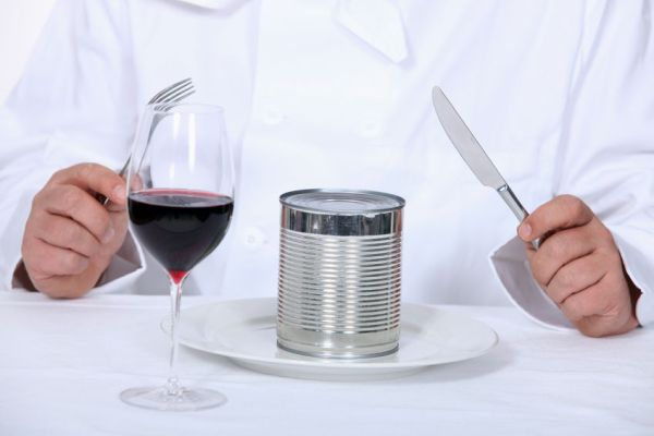 22868920 - chef sitting down to a canned dinner