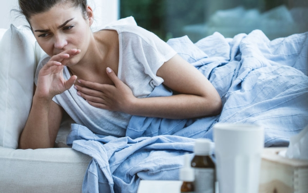 49382155 - picture of sick woman with cough and throat infection