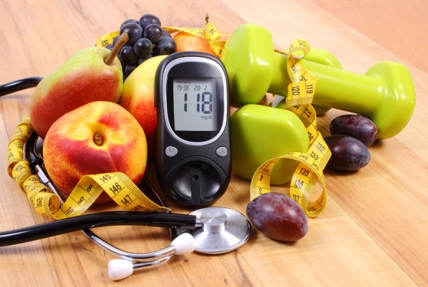 45828934 - glucose meter with medical stethoscope, fruits and dumbbells for using in fitness, concept of diabetes, healthy lifestyles and nutrition