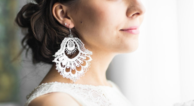 51005679 - earring in the ear of the girl.