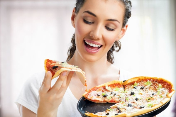 14764042 - girl eating a delicious pizza