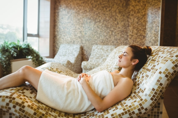 47305167 - woman relaxing while lying down at the spa