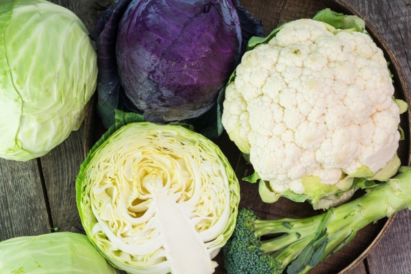 56346422 - close up of purple cabbage. cauliflower and green cabbage in a farmers tables.