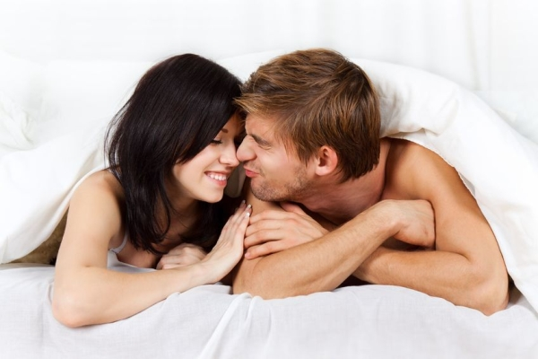 13175839 - young lovely couple lying in a bed, happy smile