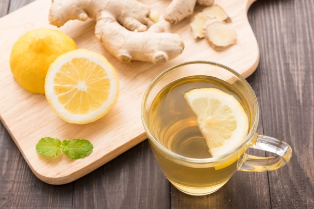 44925180 - cup of ginger tea with lemon on wooden background.