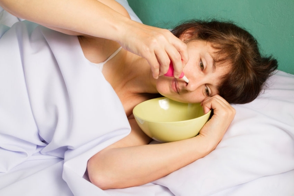 49533719 - woman lying on the bed, washes the nose.