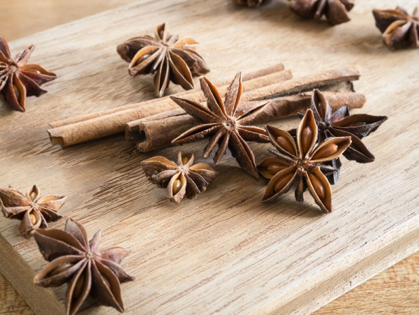 54384454 - ingredient flavor aromatic- star anise and cinnamon sticks on wooden chopping block