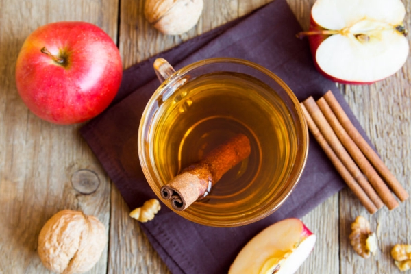 51161714 - apple tea with cinnamon over rustic wooden background