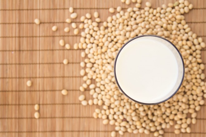 13620147 - glass of soya milk viewed from top surrounded by soya beans