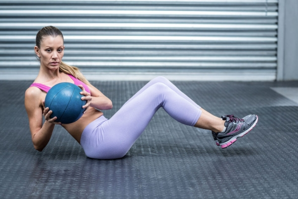 42329452 - muscular woman doing core exercises with a medecine ball