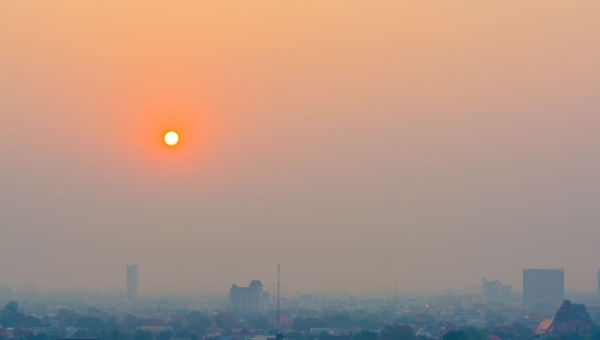 40473631 - hazy skyline of chiang mai city ,thailand smog covering buildings with sunrise .