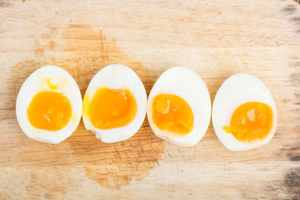 45254237 - organic boiled eggs ready to eat on wooden background