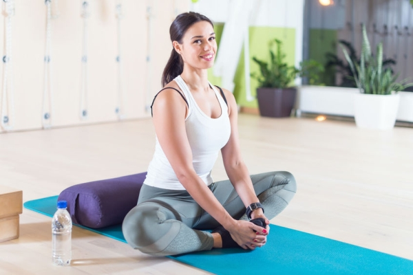 48565377 - fit woman doing stretching pilates exercises in fitness studio