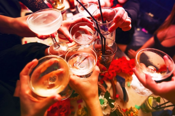 52473174 - clinking glasses with alcohol and toasting, party