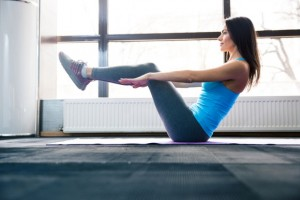 40364306 - happy young woman doing exercise on yoga mat at gym