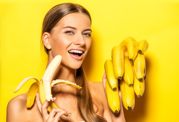 41918341 - beautiful young woman with bananas. tropical fruits. summer concept. healthy eating.