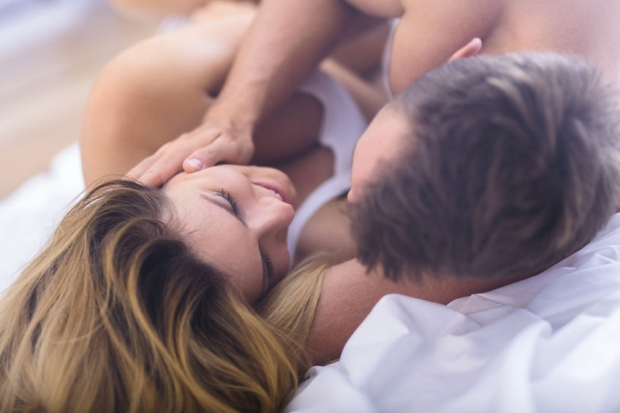 47640525 - young lovers during foreplay before morning sex