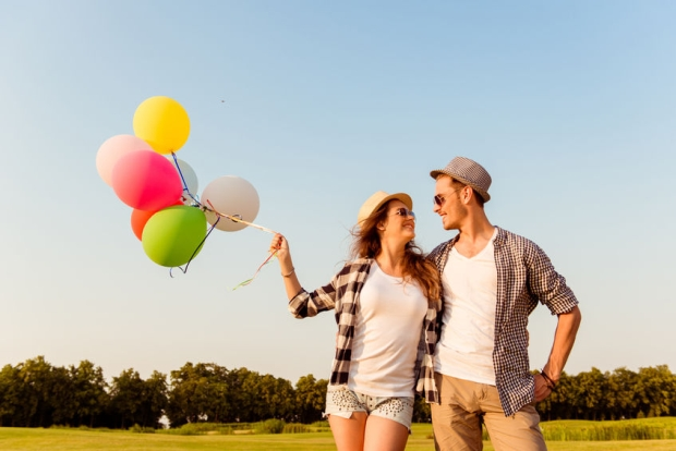 44953603 - couple in love walking with balloons