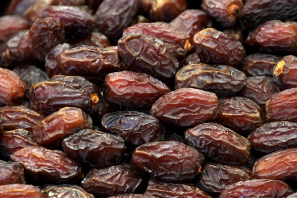 15108944 - delicious dried dates  background
