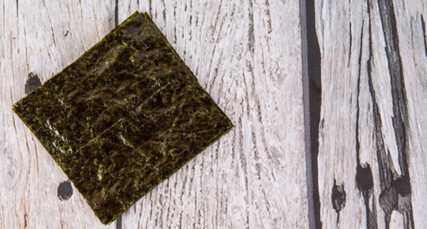 44956052 - edible seaweed or nori in japanese language over wooden background
