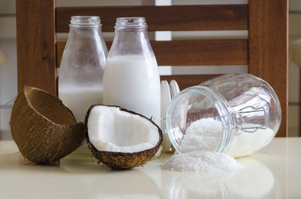 44223921 - coconut products fresh milk in glass bottles on a table