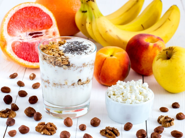 61192461 - healthy breakfast: cottage cheese and yogurt with muesli and chia seeds, fruits and nuts on white wooden background. dieting, healthy lifestyle concept meal