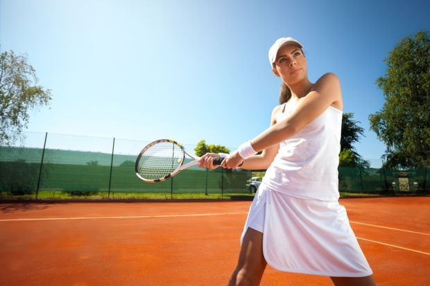 26754172 - attractive young woman playing tennis