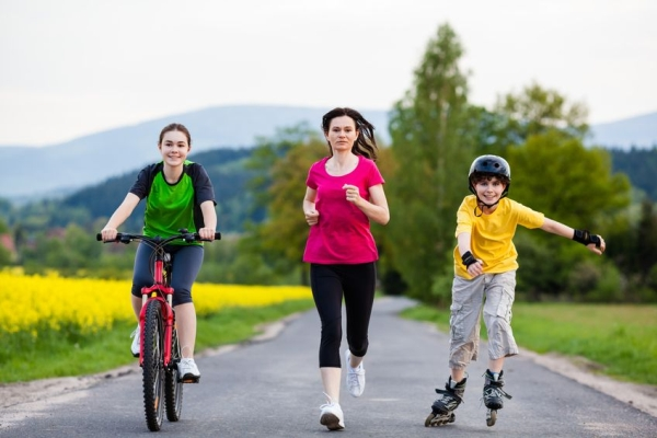 17892903 - active family - mother and kids running, biking, rollerblading