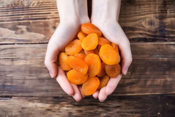 74056512 - dried apricots in hands