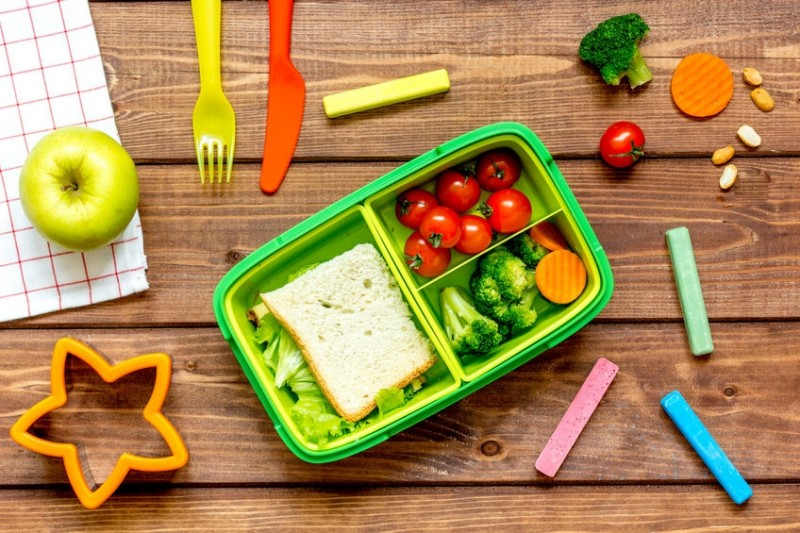 65780798 - ingredients for children's lunch on dark wooden background top view