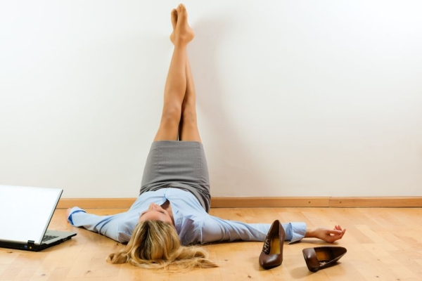 10016490 - businesswoman is lying on the floor at home relaxing