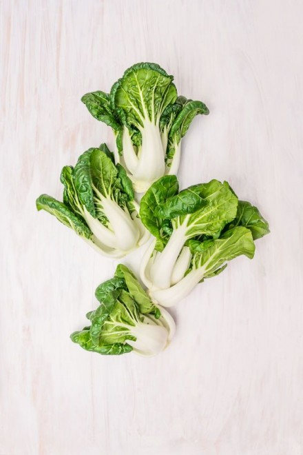 36951548 - pak choi on white wooden background, top view