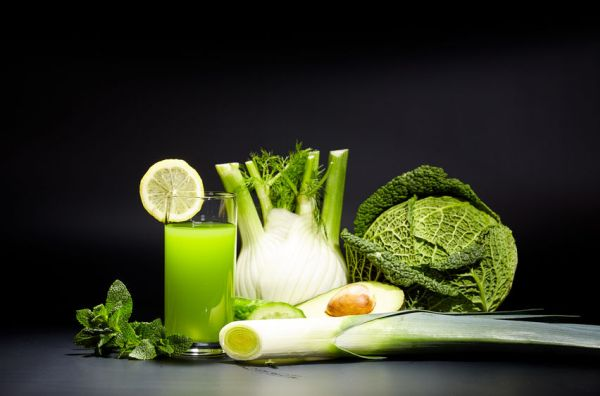 52487575 - healthy vegetable juices for refreshment and as an antioxidant . black background