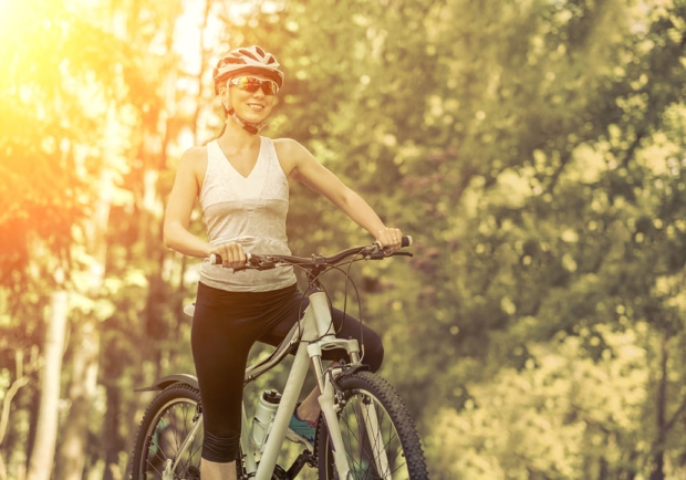 42734628 - portrait of beautiful woman on the bicycle in the park.