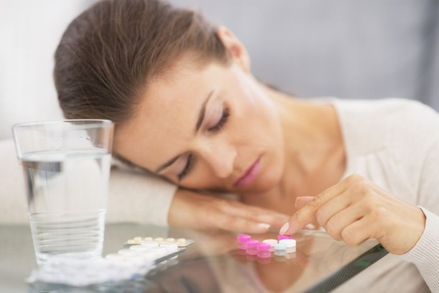 21359737 - closeup on stressed young woman playing with pills
