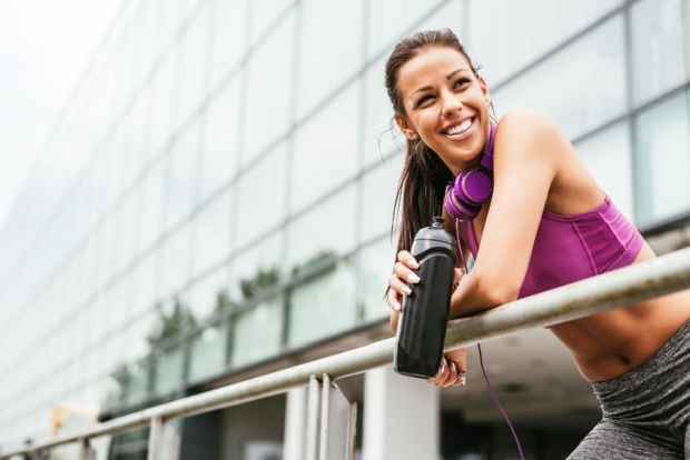 62863525 - attractive female athlete having a break from exercising.
