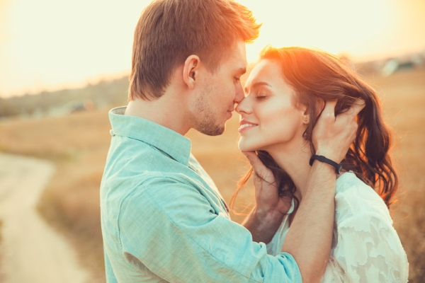 54531028 - young couple in love outdoor.stunning sensual outdoor portrait of young stylish fashion couple posing in summer in field