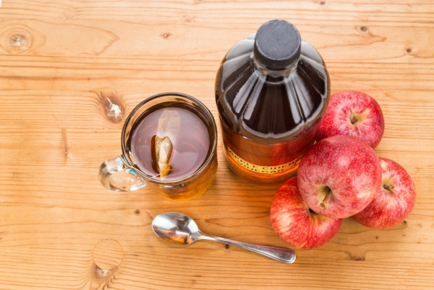 45170145 - apple cider vinegar with brewed tea, natural remedies and cures for common health condition