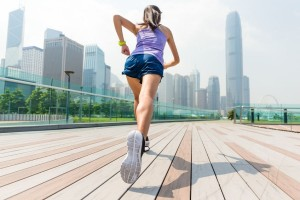 47822950 - the back view of woman running in hong kong