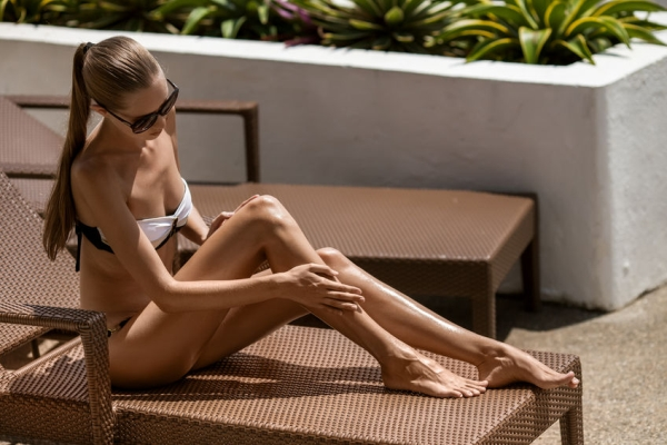 27499791 - young woman sunbathing. resort and spa.
