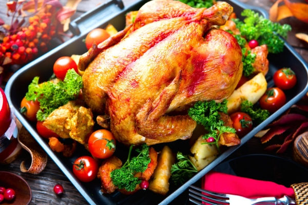 47801905 - roasted turkey garnished with potato, vegetables and cranberries. thanksgiving or christmas dinner