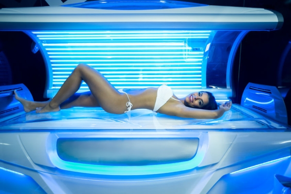 46627072 - beautiful young woman have tanning skin treatment in modern solarium