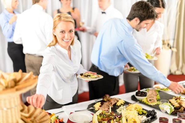 13764236 - business woman serve herself at buffet catering service company event