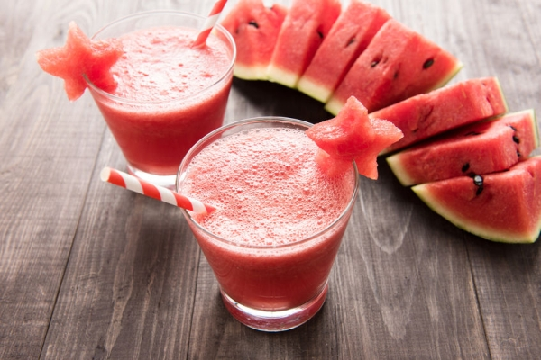 43494510 - healthy watermelon smoothie with of watermelon in star shape on a wood background