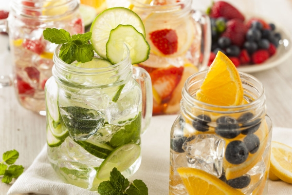 28246187 - healthy spa water with fruit on a background