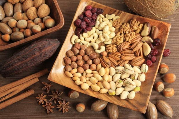 8436432 - assorted nuts in wooden bowl.