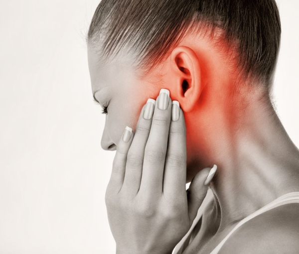 36194286 - young woman with ear pain, holding hand on his head. isolate on white background